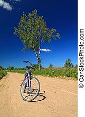 bicycle on rural sandy road