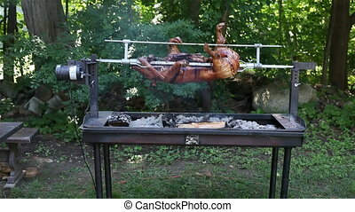 Pig roasted on barbecue fire outside