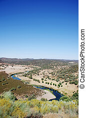 Landscape of valley and river near Barrancos, Portugal