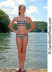 Preteen Girl at the Water - A cute preteen girl in a bikini...
