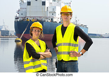 Two Dockers - Two dockers, a man and a woman, posing in...