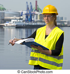 Female Inspector - Female foreman turning a page on her clip...