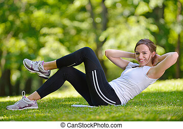 woman stretching before fitness - healthy young woman...