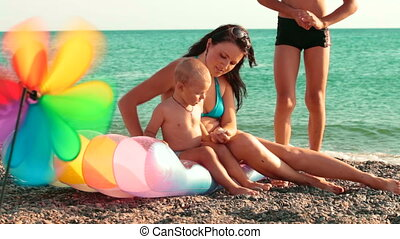 Beach Holiday - Mother with two sons enjoying summer...