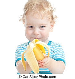 happy pretty child eating banana. healthy food eating...