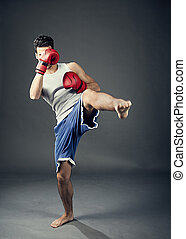 Kick boxer - photo of kick boxer hitting with his feet