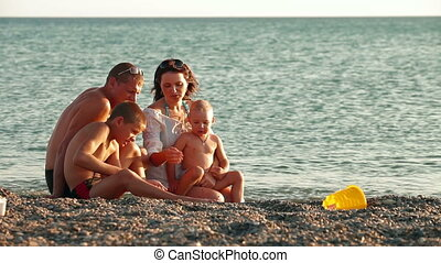 Young Family on Summer Beach