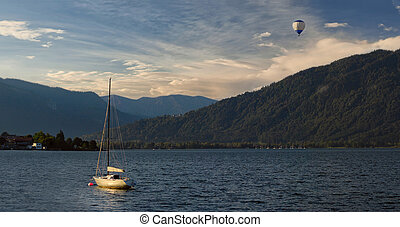 Morning on Lake Tegernsee, with yacht on water and air...