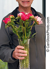 Smiling Man Giving Flowers