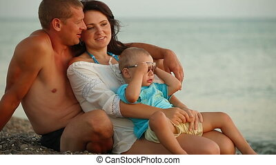 Family Relaxing on a Summer Beach