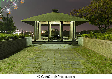 night arbor - wooden arbor in japanese park with night...