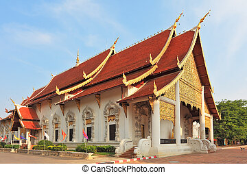 Gold-plated entrance to a Buddhist temple in northern...