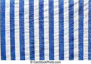 Plastic material in white and blue stripes as background