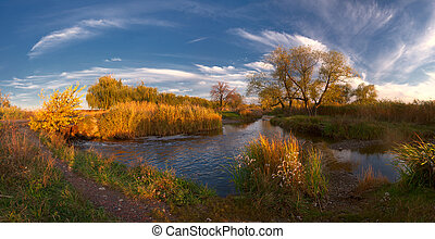 Evening river with majestic clouds - Colorful autumn...