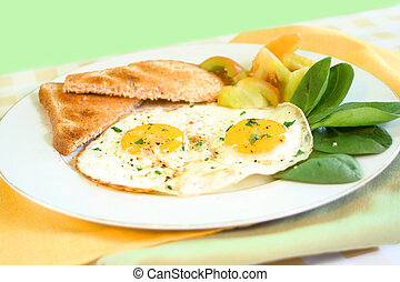 breakfast eggs - two sunny side up eggs on plate with fresh...