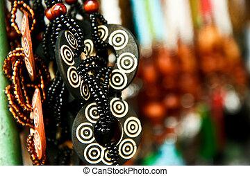 Souvenir Necklaces - Necklaces as souvenirs in a market,...
