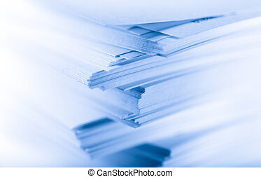 Stack of paper cards in blue