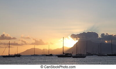 Moorea Island - Sunset behind Moorea Island Mountains seen...