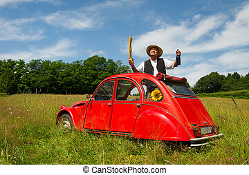 French man with his typical red car - French man is holding...