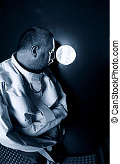 Mentally ill man looking out his cell - Photo of an insane...