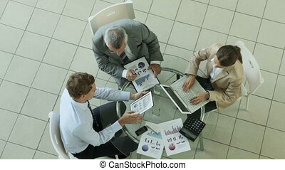 Lots of work - High angle view of a business group analyzing...