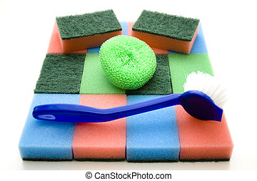 Pot sponges with brush on white background