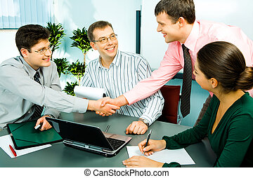 Business meeting - Photo of handshake of businesspeople with...