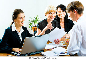 Business training - Three businesswomen looking at...