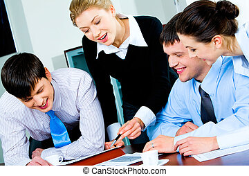 Business group at work - Group of four happy business...