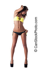 cute young woman in yellow swimsuit isolated