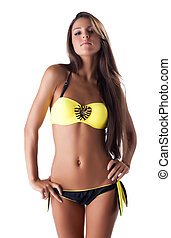 pretty young woman in yellow swimsuit isolated