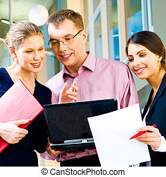 Computer work - Portrait of a business group looking at the...