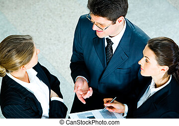 Speaking businesspeople - View from above of speaking...
