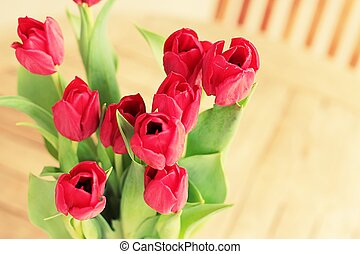 home decoration, vase of red flowers on garden table - a...