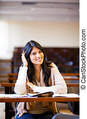 happy female university student in lecture hall