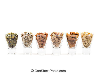 different nuts - coctail of different nuts in short glasses,...