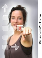 young woman pointing at a digital interface on a delete key