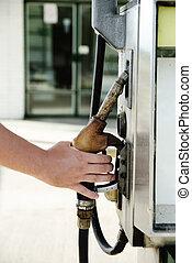 Fuel Pump - Man hand holding fuel pump
