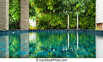 Swimming pool side in garden