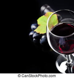 Wine - Glass of  wine and grape on black background