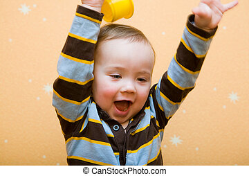 The happiness - small glad baby boy in striped shirt