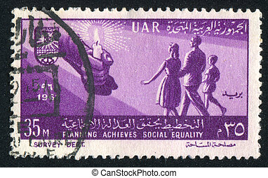 Hand with candle - EGYPT - CIRCA 1961: stamp printed by...