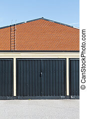 Garage door in front of a brickwall building