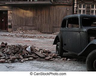 old car beside vintage old house