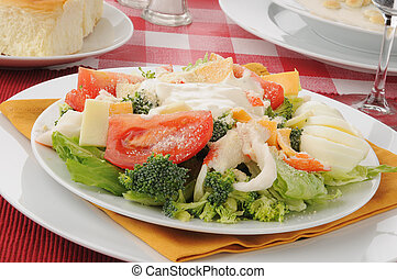 Crab Salad - A plate of crab salad with cheese and tomatoes