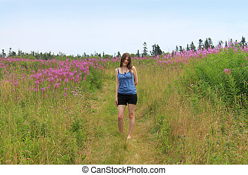 Pretty woman in field of lupins