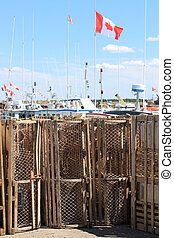 Lobster traps in PEI - Lobster traps on shore with boats and...