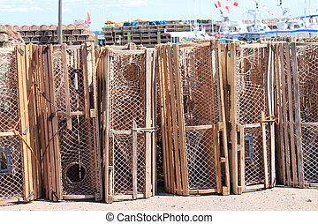 Lobster traps in PEI - Lobster traps on shore with boats in...