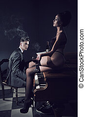 Sexy couple with piano