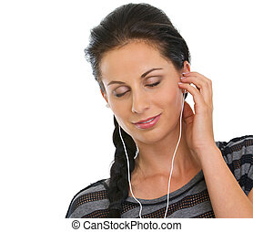 Portrait of girl with headphones relaxing by listening music